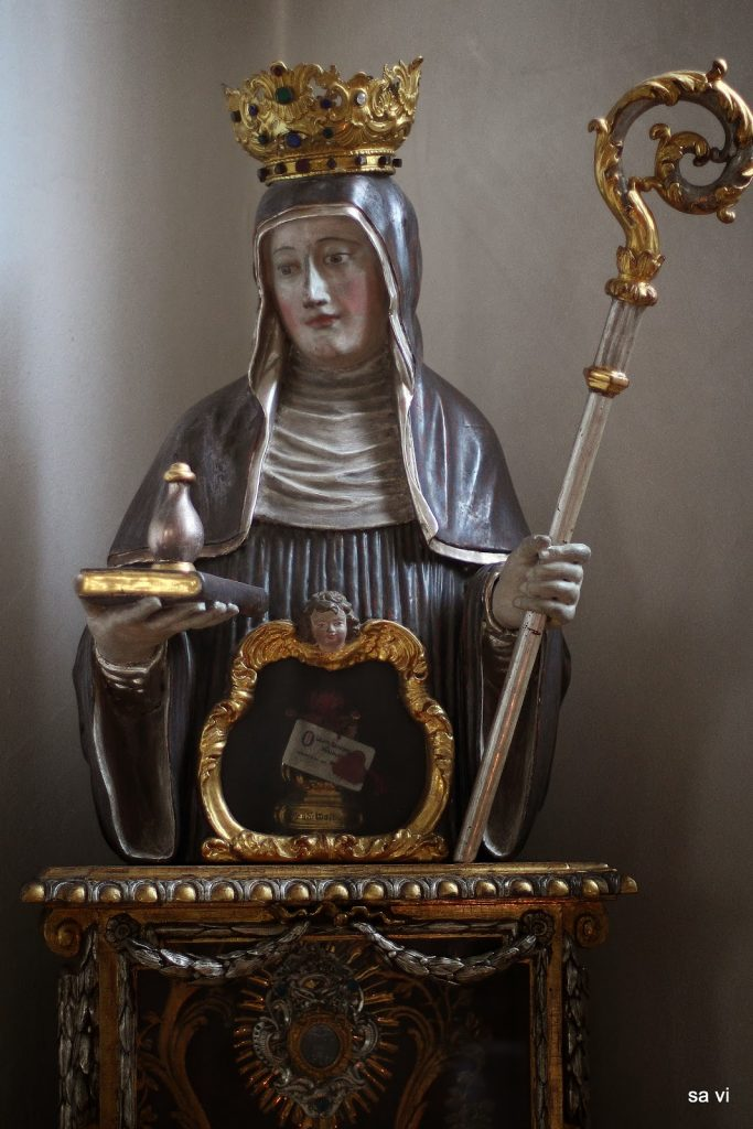 St. Walpurga with a vial of her holy bone-drippings.